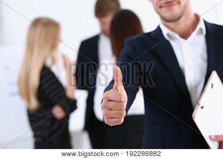 Handsome Smiling Man Showing Ok Or Approval Sign