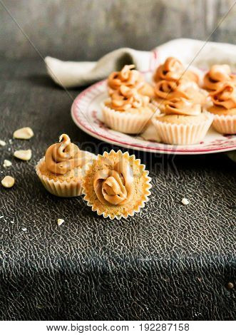 Homemade mini cupcakes with peanut butter, selective focus