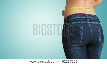 Young woman measuring tape young adult background view