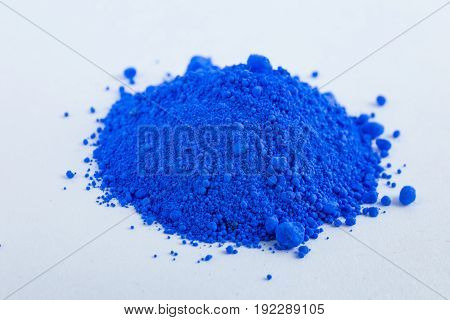 Cobalt blue pigment on a white background