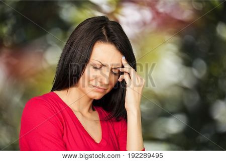 Head woman headache depressed young adult background view