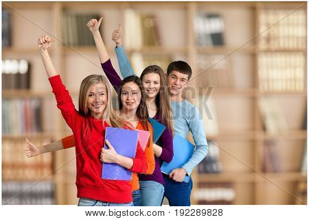 Gesturing students thumbs up group white background isolated