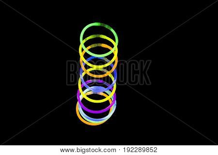 Bracelet jewel made with glow sticks neon light fluorescent on back background. Nightclub cocktail bar atmosphere