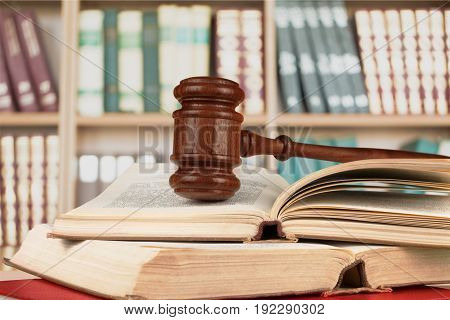 Wooden hammer books judge objects background brown