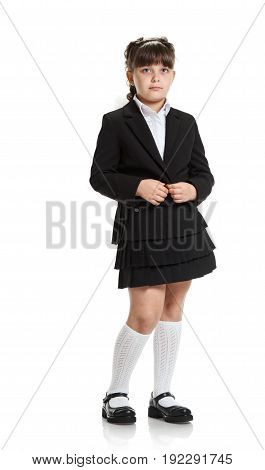 Full portrait of pretty young female pupil in school uniform