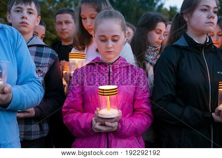 Yoshkar-Ola, Russia - June 21, 2017 An unknown girl holds a candle during the annual international action Candle of Memory. Dedicated to the 76th anniversary of the beginning of the Great Patriotic War