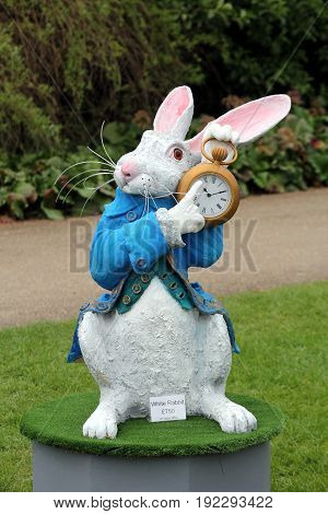 Wisley, Surrey, Uk - April 30 2017: Garden Ornament Or Statue Of The White Rabbit From