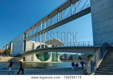 BERLIN, SEP,24, 2006: View on German Chancellor Angela Merkel (Bundeskanzleramt) hi tech modern style Berlin architecture building, Berlin river Spree, walking people, tourists, garden Spreebogenpark