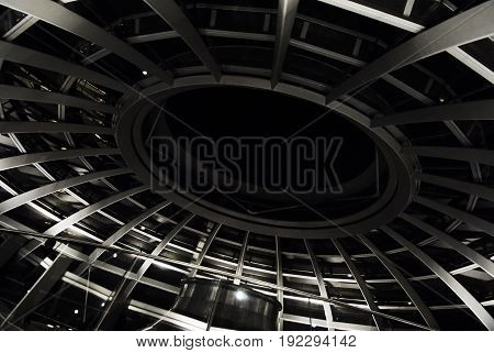 Metal steel swirl spiral footwalk staircase stair top construction. Abstract fractal background texture building interior architecture. Modern Berlin architecture. Abstract fractal architecture