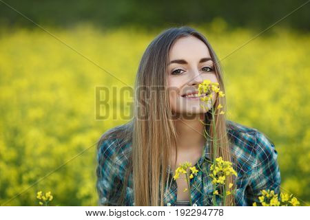 Attractive Young Blonde Woman In Blue Plaid Shirt Straw Hat Enjoying Her Time On Bright Colorful Blo
