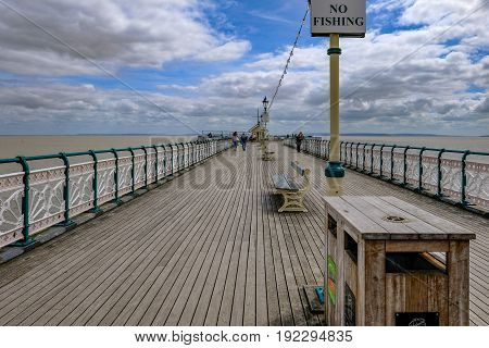 Penarth Wales - May 21 2017: On Penarth Pier with wooden floor and art deco railings.