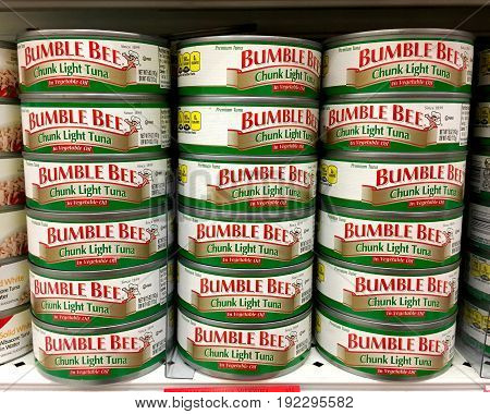 Alameda CA - January 17 2017: Grocery shelf with Bumble Bee brand Chunk Light Tuna packed in oil.