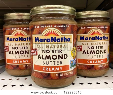 Alameda CA - January 17 2017: Grocery shelf with jars of MaraNatha brand all natural no stir creamy Coconut Almond Butter.