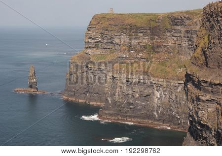 Cliffs of Moher with crashing waves on rocks
