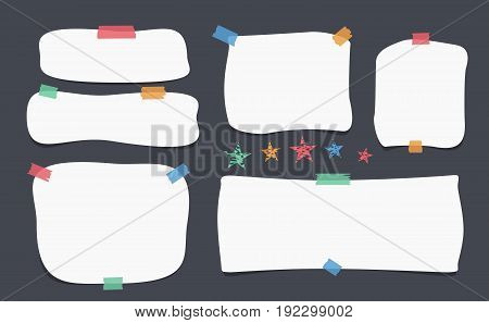 White blank note, notebook, copybook sheets with rounded corners stuck with colorful sticky tape on black background
