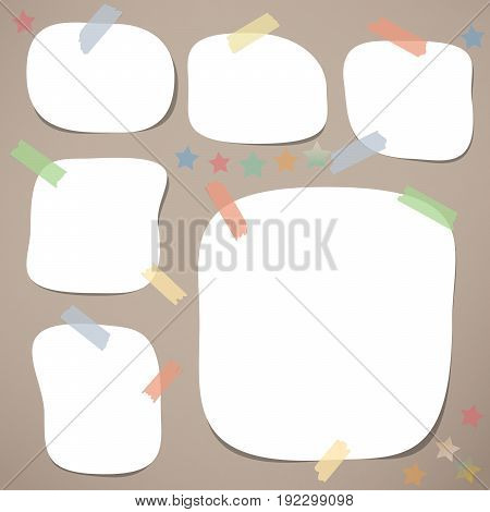 White blank note, notebook, copybook sheets with rounded corners stuck with colorful sticky tape on brown background