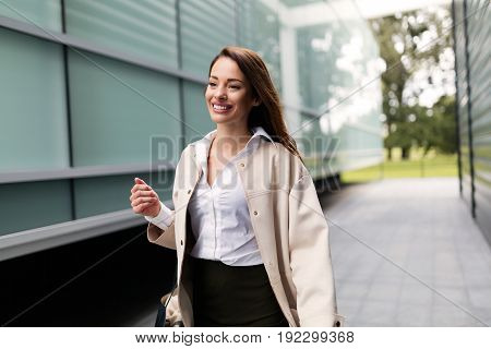 Professional beautiful and attractive businesswoman posing in front of office