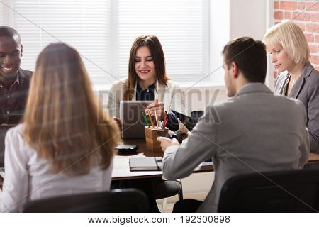 Smiling Young Female Manager With Her Colleague In Office Meeting