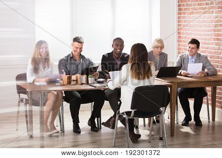 Group Of Diverse Businesspeople In A Meeting At Office