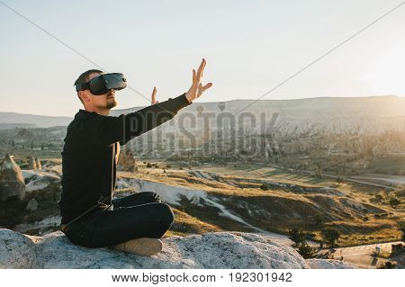 The man with glasses of virtual reality. Future technology. Modern imaging technology.