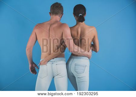 Man And Woman Embrace In Stylish Jeans