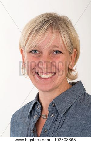 headshot portrait of a beautiful blonde european middle age women dressed in gray business jacket - studio shot in front of a white background