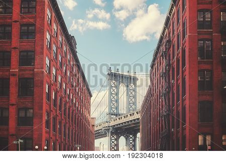 Color toned picture of Manhattan Bridge seen from Dumbo New York City USA.