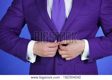 Man With Hands Buttoning Buttons On Elegant Suit Jacket