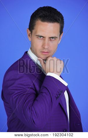Handsome Man With Serious Face Posing In Violet Suit Jacket