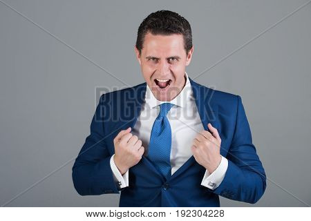 Business Success Of Excited Businessman Tearing Jacket Like Superman