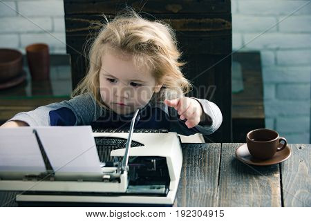 Small Boy Or Businessman Child With Typewriter