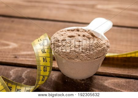 Sport and diet nutrition with equipment on wooden table background top view