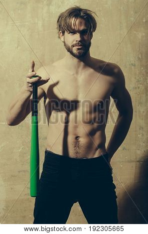 Man With Athletic Torso Holding Baseball Bat In Hand