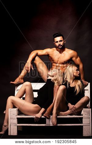 Man With Muscular Body With Twin Girls