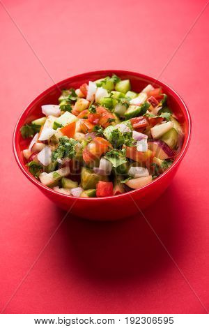 Indian Green Salad also known as Kachumber is a colourful salad dish in Indian cuisine consisting of fresh chopped tomatoes, cucumbers, onions, and sometimes, chili peppers. selective focus