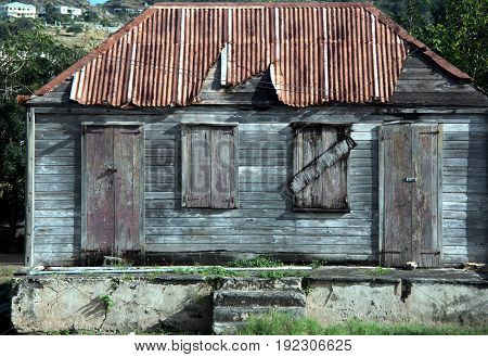 Old rusty abandoned shack in the caribbean.