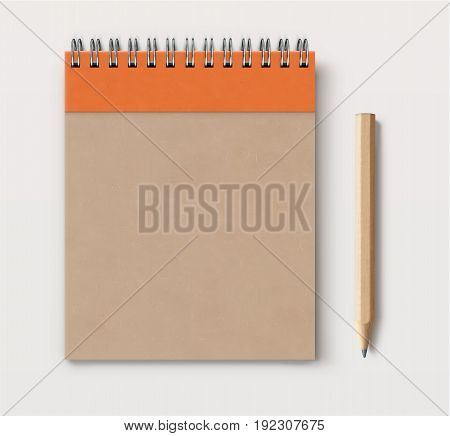Vector illustration of top view of closed spiral brown craft paper cover notebook with detailed classic wooden pencil on white desk background