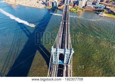 Aerial view of the Manhattan Bridge over the East River in New York City at sunset