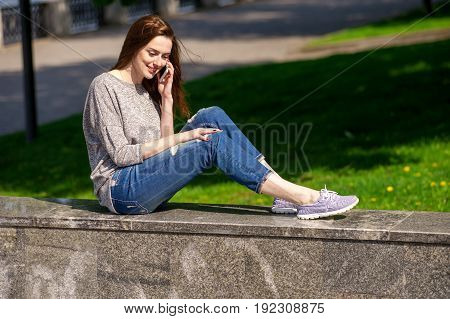 Girl Is Sitting On A Parapet 03