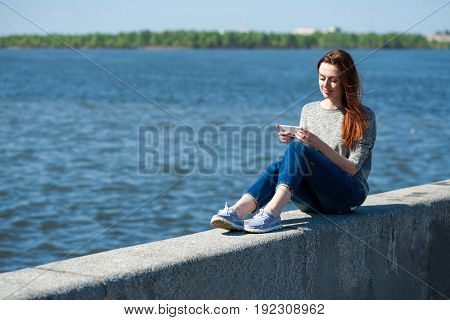 Girl Is Sitting On A Parapet 02