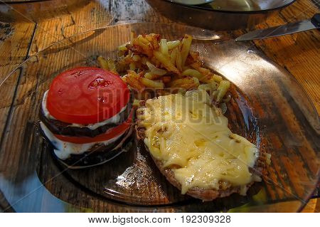 Aubergines tomatoes French fries meet with cheese
