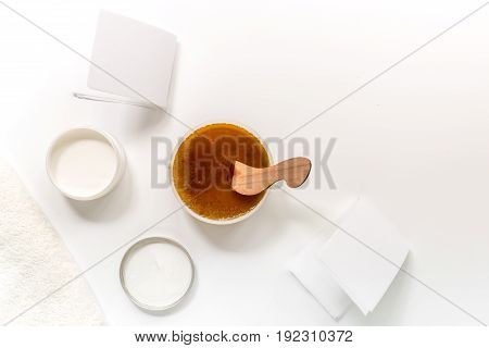 Preparing for depilation with wax on white background top view copyspace.