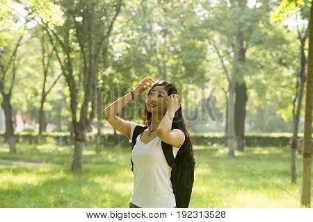 Girl Basking In The Sun On The Grove