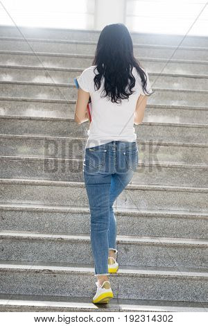 Adult Student Walking At Stairs In Campusrear View