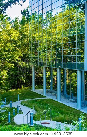 TWINSBURG OH - JUNE 12 2016: A modernistic glass wall of the Twinsburg branch of the Cleveland Clinic beautifully mirrors the natural setting that surrounds it.