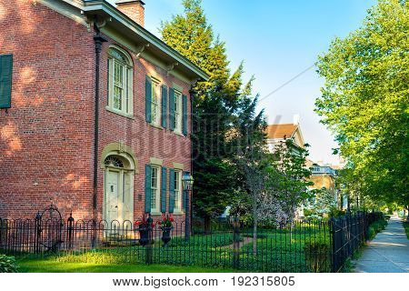 GRANVILLE OH - MAY 15 2016: A quiet residential block of Broadway Avenune in this east central Ohio village sports colonial style architecture and well-kept gardens.