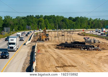 OAKWOOD VILLAGE OH - JUNE 3 2017: Road construction on I-271 southeast of Cleveland has the median completely torn up in preparation for adding lanes.