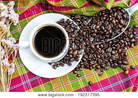 Coffee cup with coffee beans on loincloth