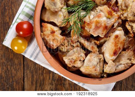 Roasted chicken meat pieces. Grilled boneless skinless chicken thigh. Top view.
