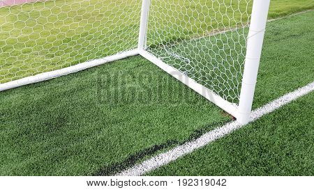 Bottom Of Triangle Corner Of Football Goal On Green Lawn